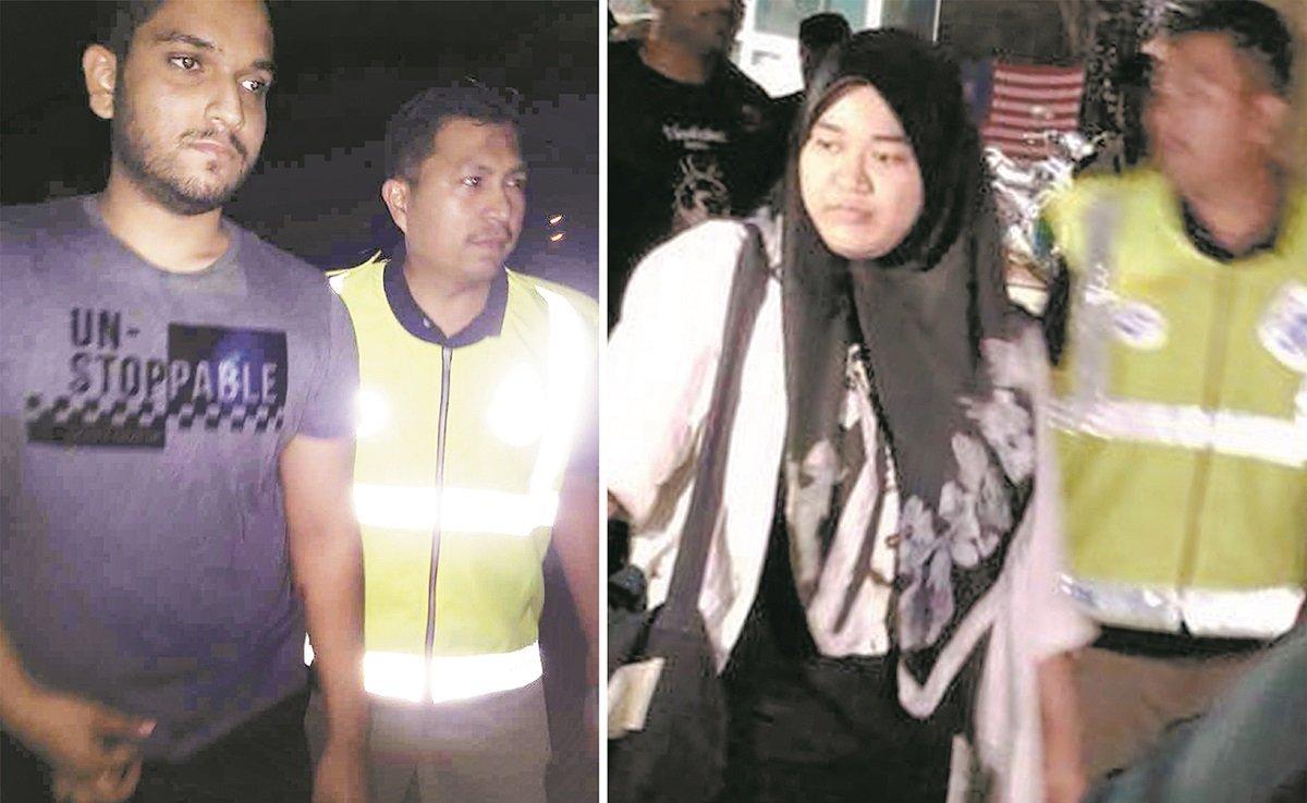 两名参与静坐抗议行动的大学生阿希阿里(左)和西蒂诺伊莎(右),被警方带走扣查。
