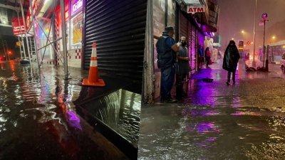 """飓风""""艾达""""持续影响美东三州地区,强降雨让纽约市多处地区出现严重积水,道路、地铁大淹水。(图取自法新社)"""
